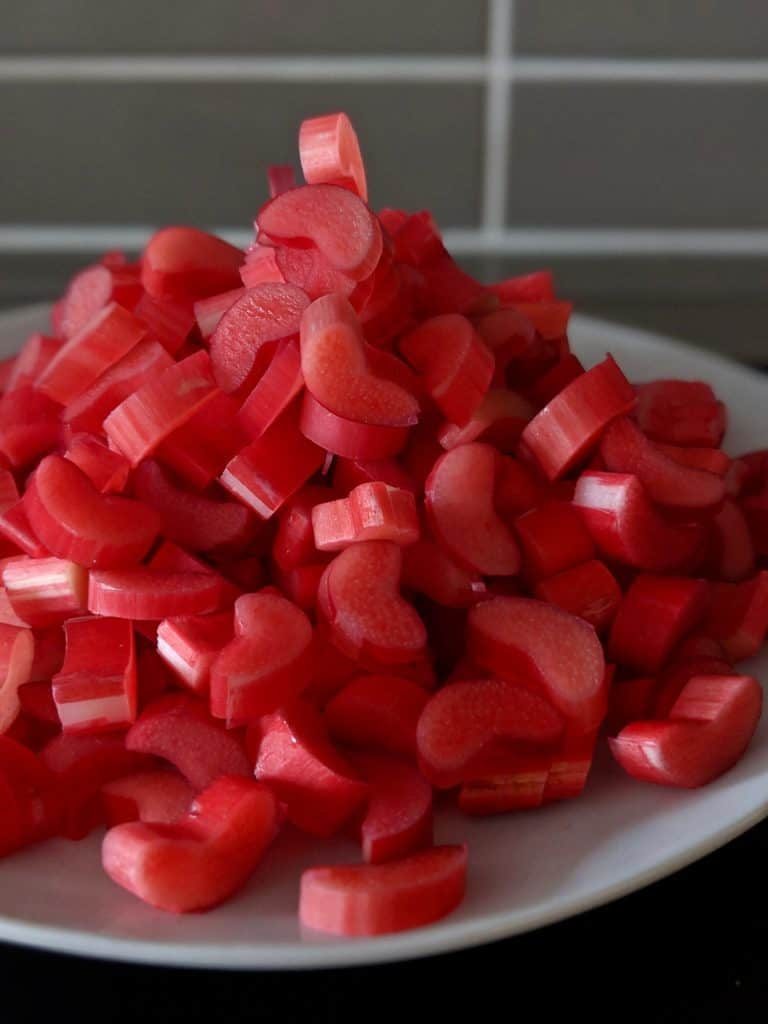Rhubarb is chopped up and ready to be stewed.