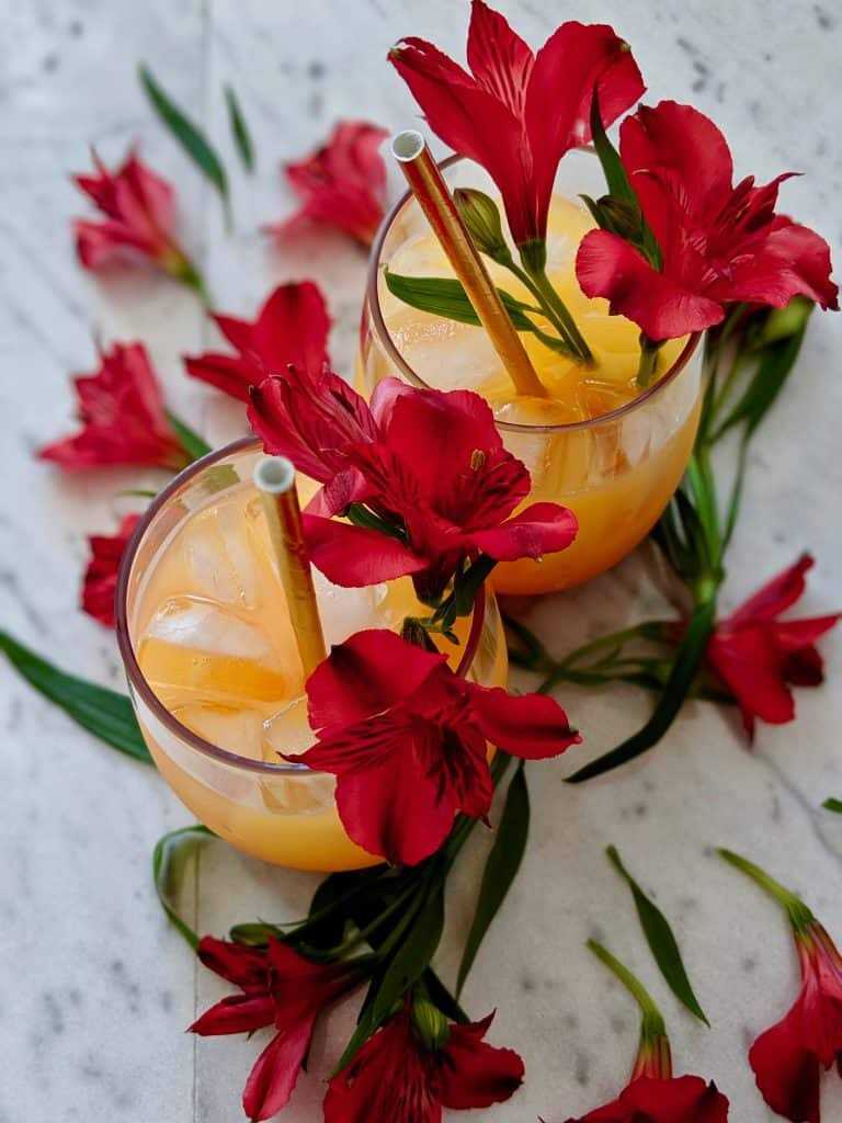 Bahamas rum punch decorated with flowers for an extra tropical look.