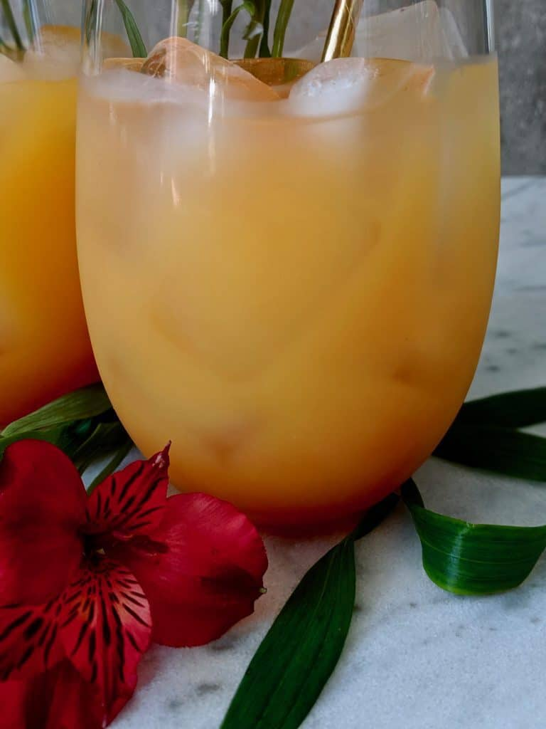 A close up of a glass of Bahamas rum punch.
