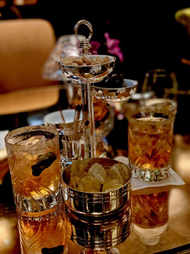 Cocktail and snacks from Bar Hemingway, Paris.