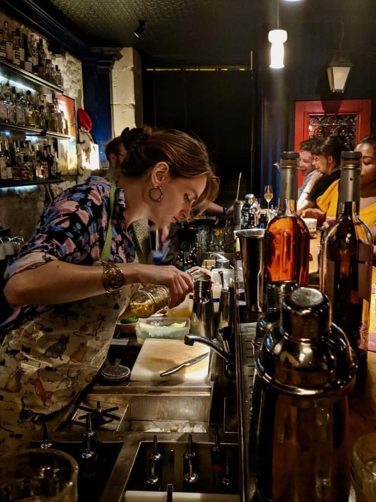 A bartender slinging drinks at Little Red Door, Paris.