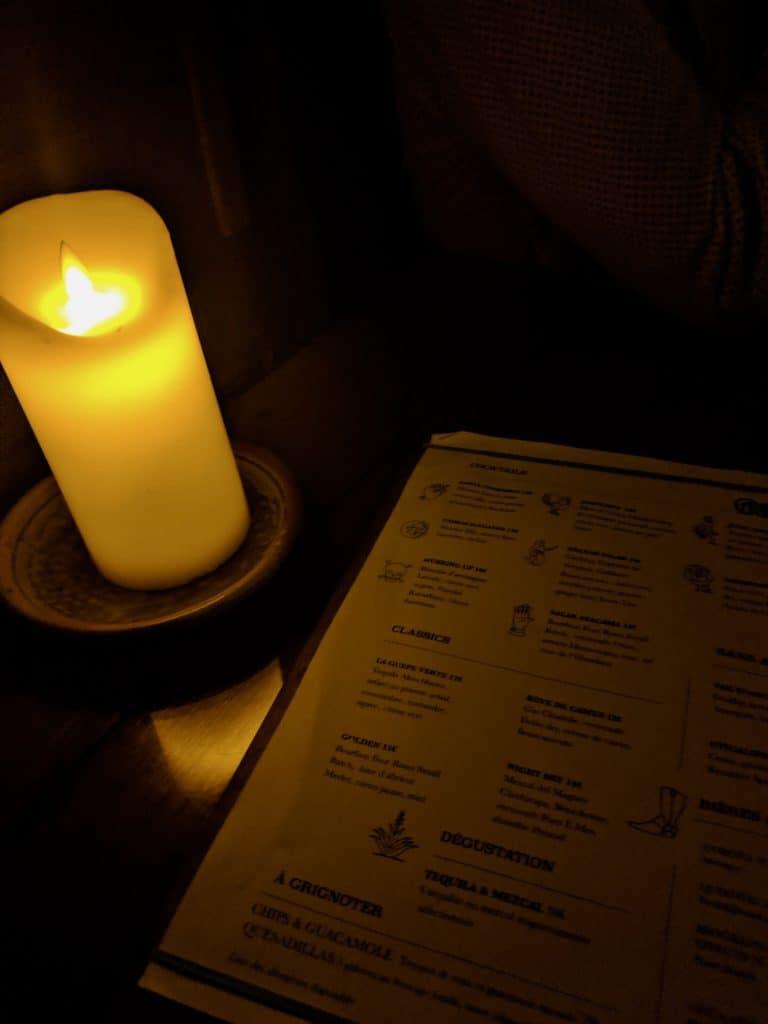 A candlelit menu at Candelaria, Paris.
