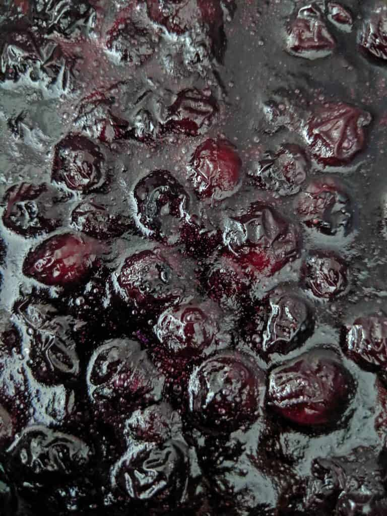 Once the first half of the blueberries are cooked, mash 1/2-3/4 of them with a fork before mixing in the remaining berries.