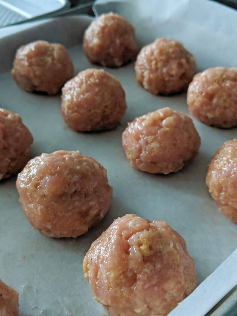 The meatballs are baked for 15 minutes.