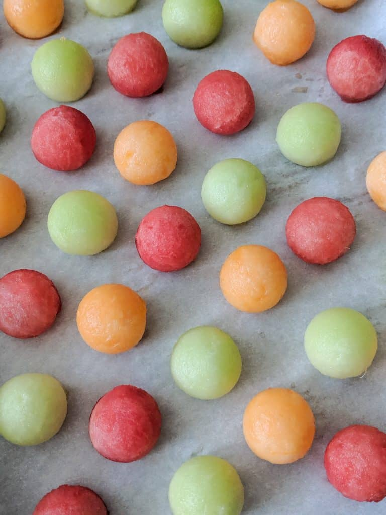 Set the melon balls spaced apart on a tray covered with parchment or wax paper.