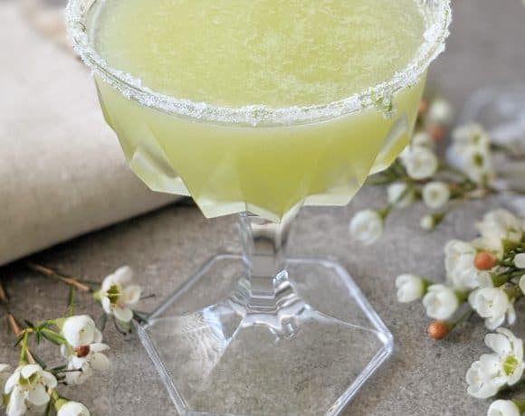 Beautiful and delicious melon margarita. Shaking the cocktail infuses air to give it a pretty cloudiness.
