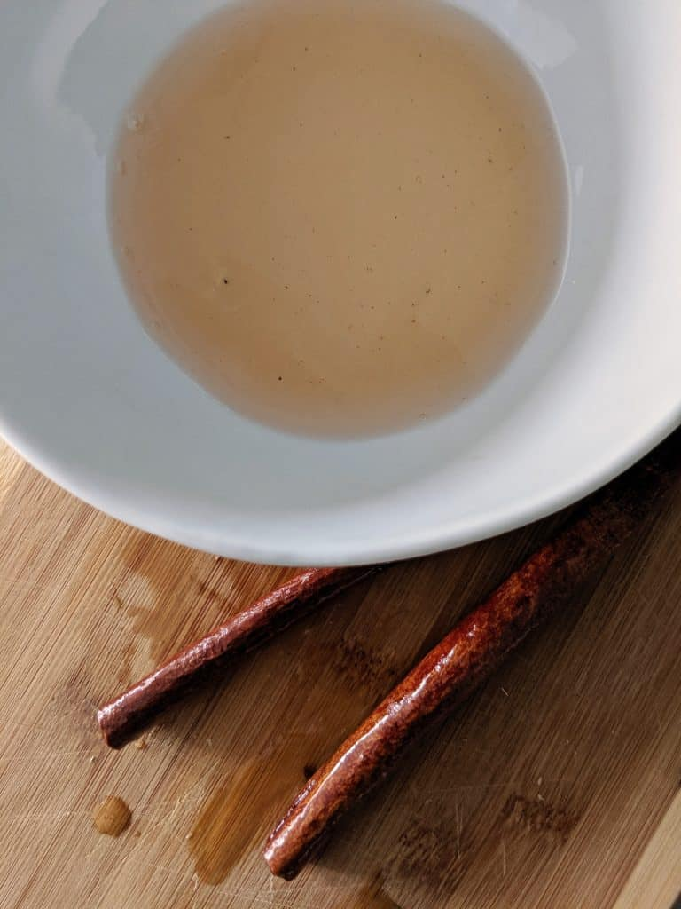 Spiced syrup and reserved cinnamon sticks.