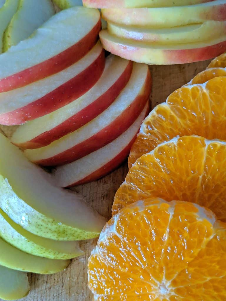 Honeycrisp apples, pear, and mandarin orange are sliced thinly.