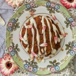 And overhead shot of carrot cake pancakes on a floral plate.