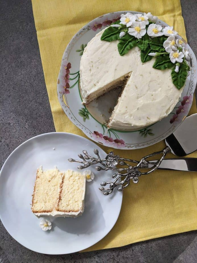 A lemongrass cake with a slice cut out of it.