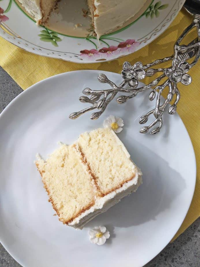 A slice of lemongrass cake on a white plate.