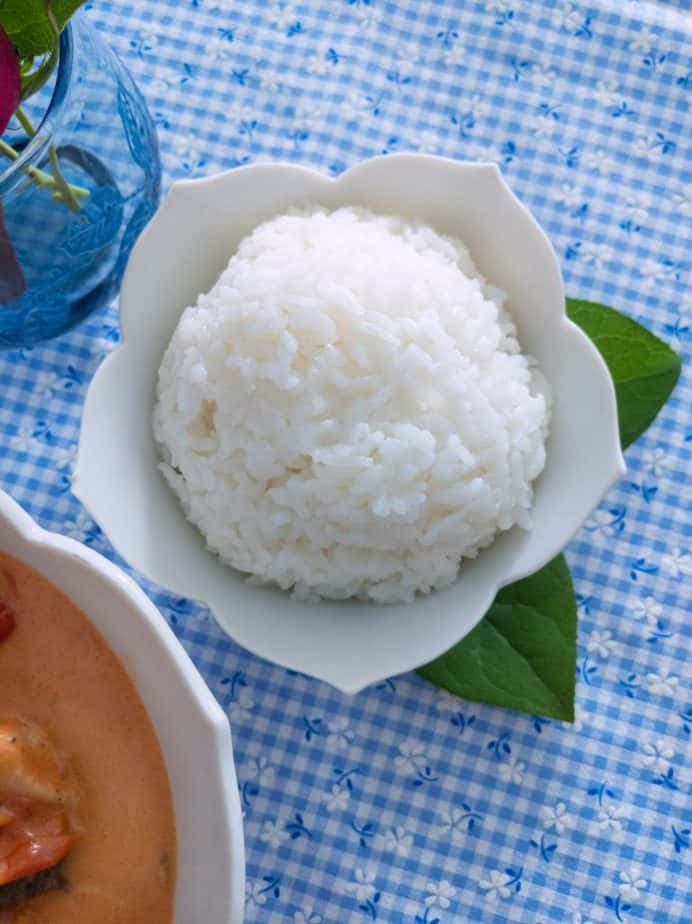 White rice in a white, flower-shaped bowl.