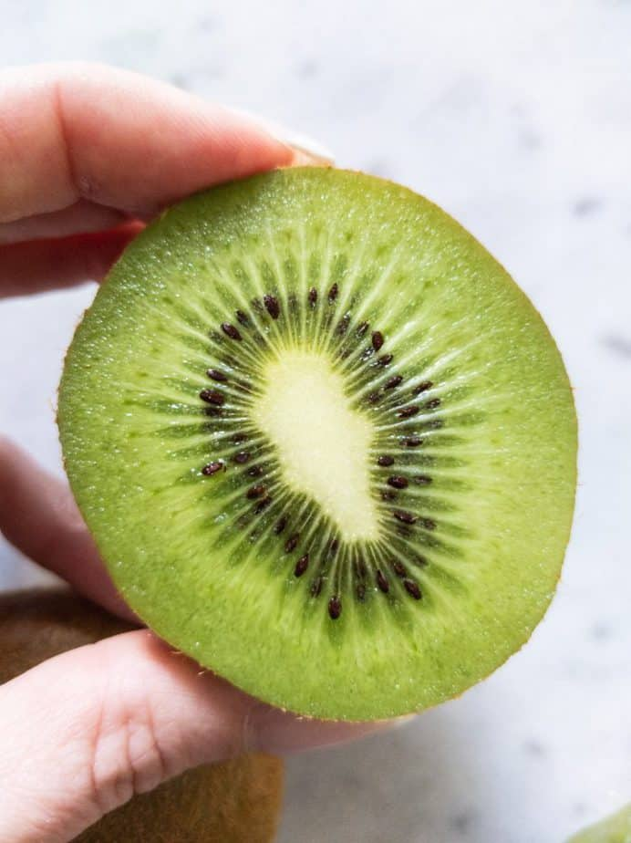 A close up of a halved kiwi.