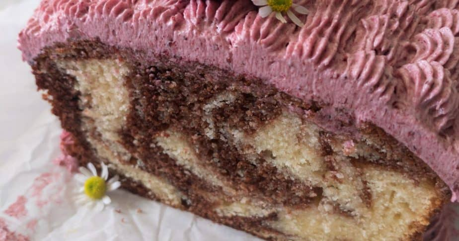 A close up of the chocolate swirls inside of a marble cake.