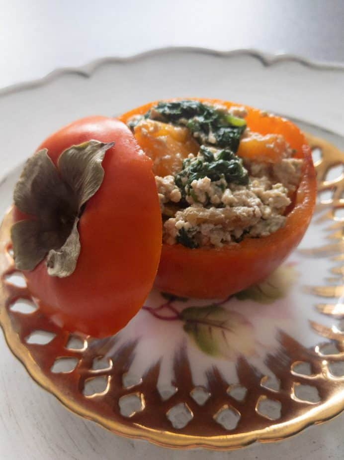 Japanese persimmon shiraae served in a persimmon bowl on a golden plate.