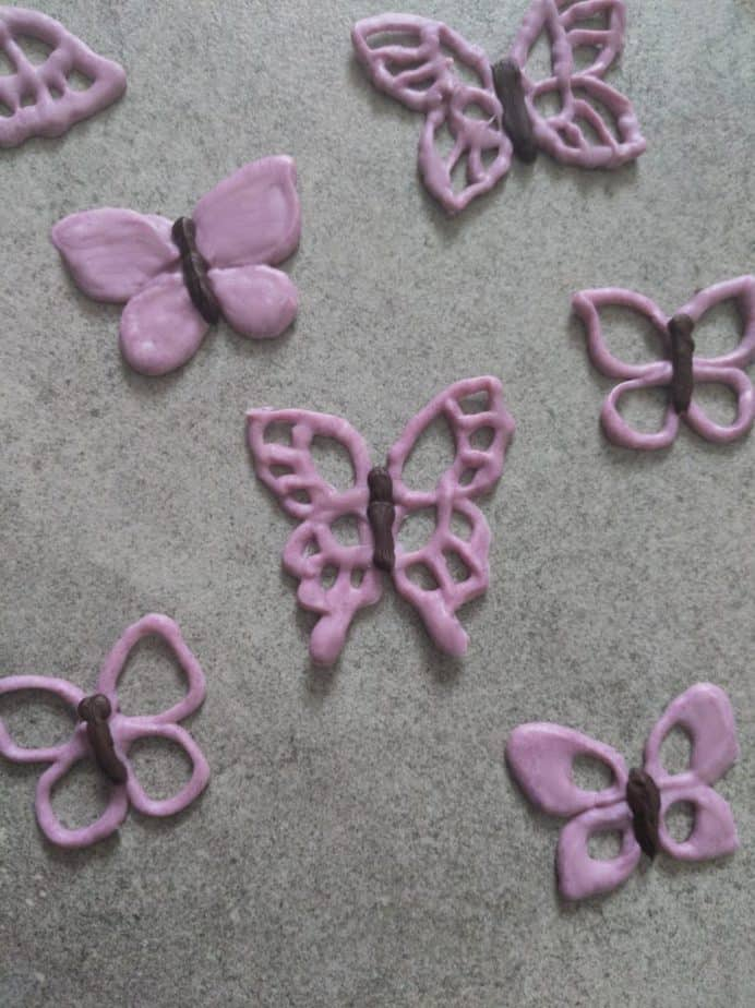 Tempered chocolate purple butterflies.