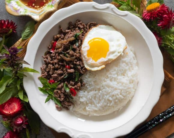 Thai basil beef stir fry topped with a crispy Thai-style fried egg.