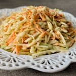 Coleslaw on a detailed white plate
