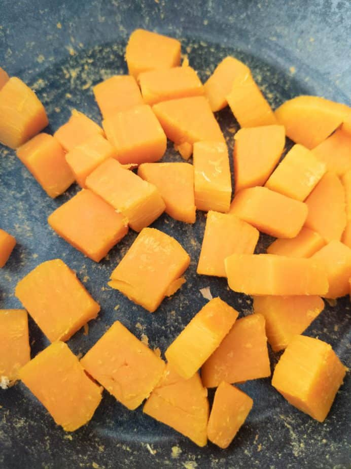 Diced persimmon roasting in a dry pot to remove moisture.