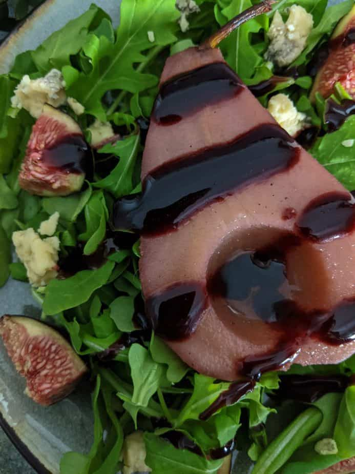 A closeup of poached pear salad.