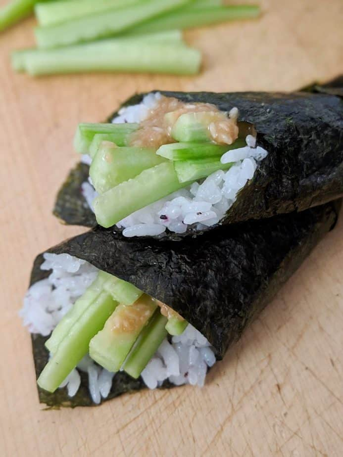 Two sesame cucumber hand rolls