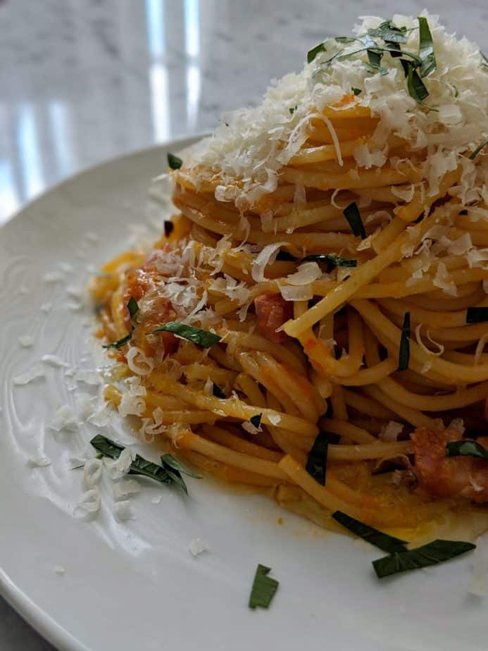 Spaghetti all'Amatriciana on a white plate
