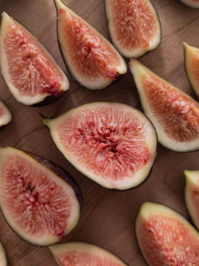 A close up of halved and quartered figs.