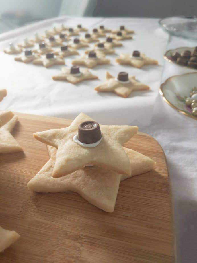 Two rolo-topped sugar cookie stars stacked and glued together.