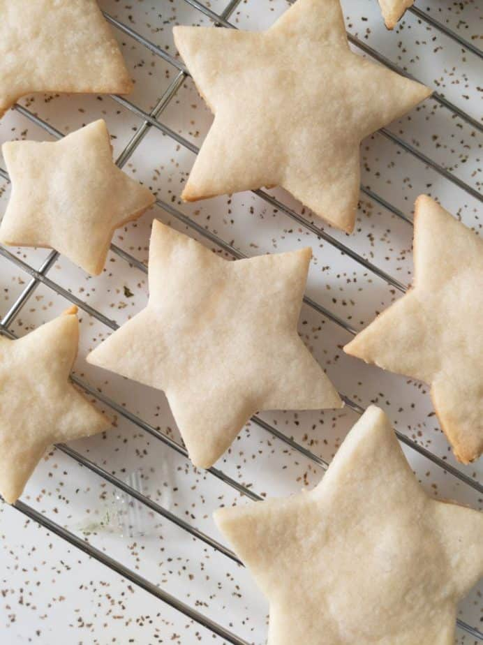 Star-shaped sugar cookies on a cooling rack.