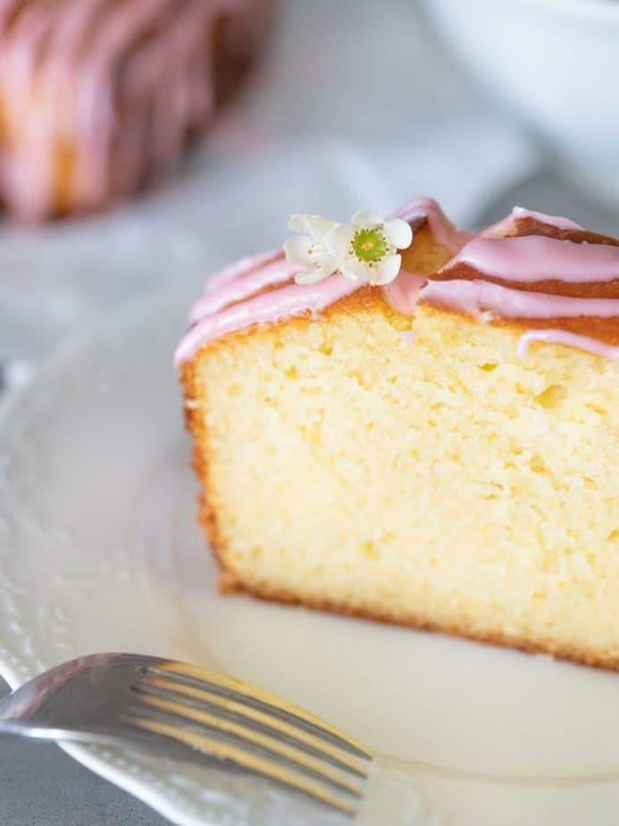 A close up of a slice of French yogurt cake on a white plate.