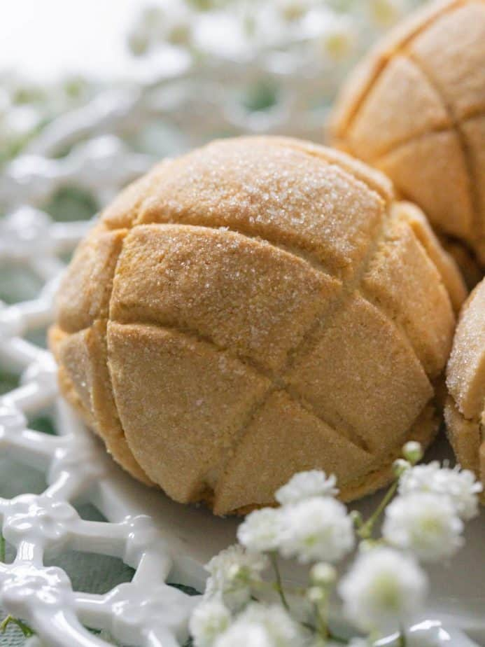 A close up of melon bread on a white plate.