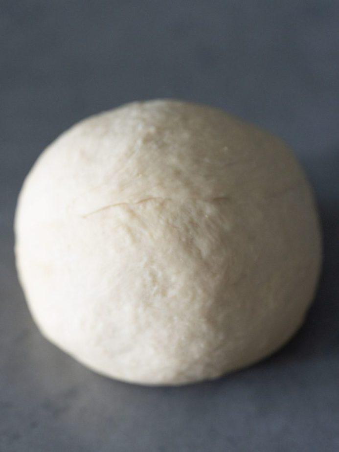 A ball of bread dough rising.
