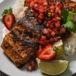 Blackened salmon on a bed of rice topped with strawberry pineapple salsa.