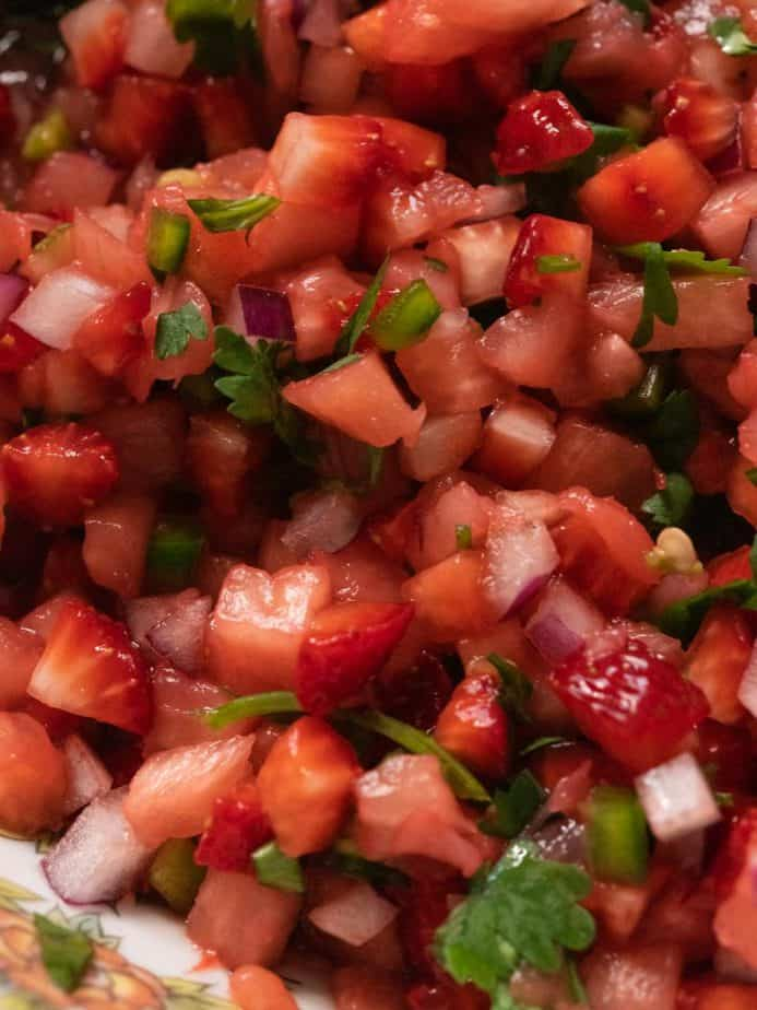 A close up of strawberry pineapple salsa.